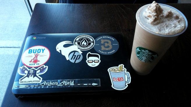 My Chrombook, replete with stickers, and a frappuccino at the Starbucks